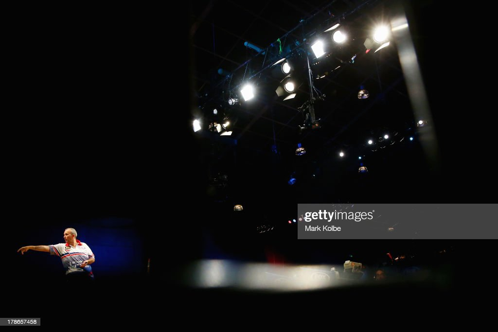 <a gi-track='captionPersonalityLinkClicked' href=/galleries/search?phrase=Phil+Taylor+-+Darts+Player&family=editorial&specificpeople=184525 ng-click='$event.stopPropagation()'>Phil Taylor</a> of England in action during his quarter-final match against Paul Nicholson of England during day two of the Sydney Darts Masters at Luna Park on August 30, 2013 in Sydney, Australia.