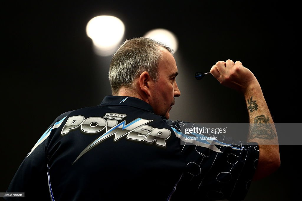 Phil Taylor of England in action during his second round match against Mark Webster of Wales on Day Eight of the William Hill PDC World Darts Championships at Alexandra Palace on December 28, 2014 in London, England.