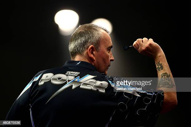 Phil Taylor of England in action during his second round match against Mark Webster of Wales on Day Eight of the William Hill PDC World Darts...