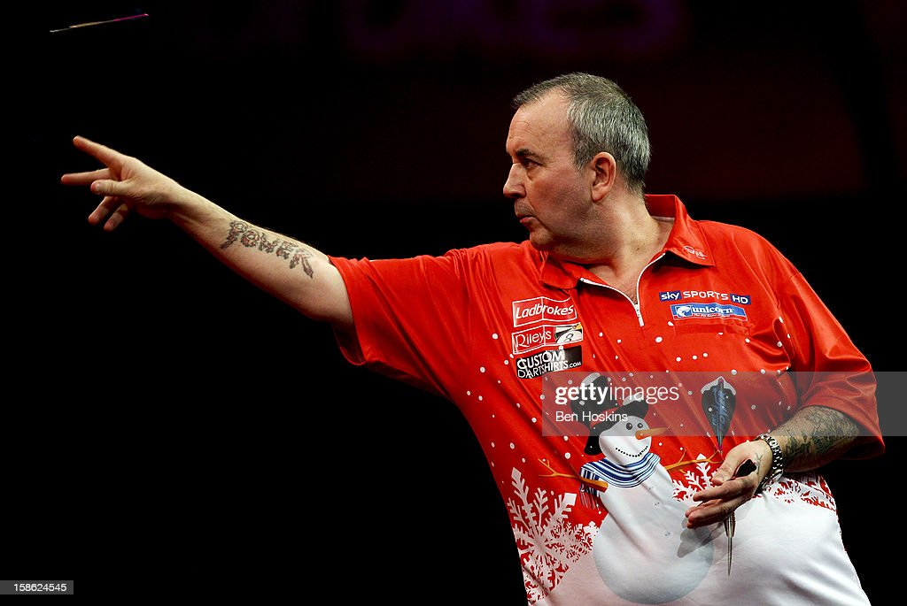Phil Taylor of England in action during his second round match on day eight of the 2013 Ladbrokes.com World Darts Championship at the Alexandra Palace on December 21, 2012 in London, England.