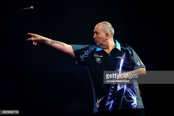 Phil Taylor of England in action in his third round match against Jelle Klaasen of the Netherlands on Day Twelve of the 2016 William Hill PDC World...
