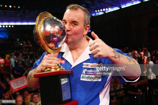 Phil Taylor of England poses with the trophy after winning the World title for a record fifteenth time by beating Simon Whitlock of Australia in the...