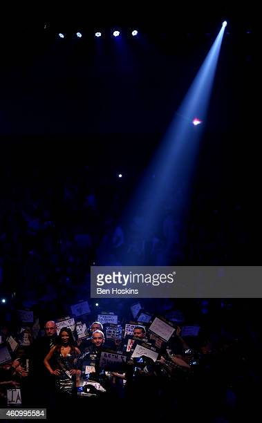 Phil Taylor of England prepares to walk on ahead of his semi final match against Raymond van Barneveld of the Netherlands on day thirteen of the 2015...