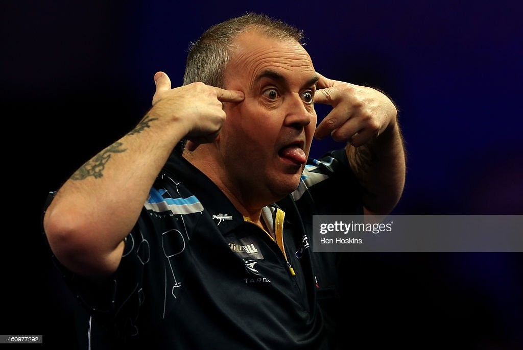 Phil Taylor of England reacts after winning a set during his quarter final match against Vincent van der Voort of the Netherlands on day twelve of the 2015 William Hill PDC World Darts Championships at Alexandra Palace on January 2, 2015 in London, England.