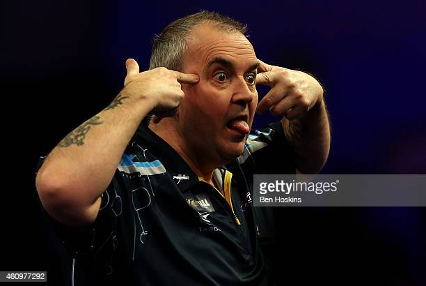 Phil Taylor of England reacts after winning a set during his quarter final match against Vincent van der Voort of the Netherlands on day twelve of...