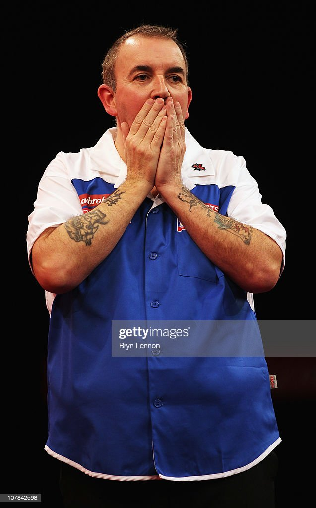 Phil Taylor of England reacts during his match against Mark Webster of Wales during the quarter finals of the 2011 Ladbrokes.com World Darts Championship at Alexandra Palace on January 1, 2011 in London, England.