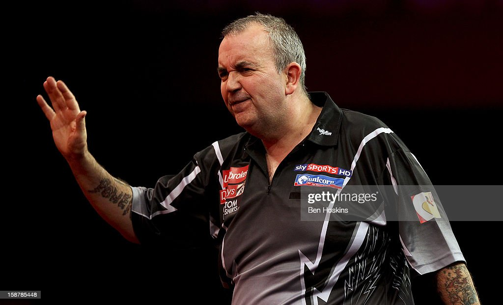 Phil Taylor of England reacts during his quarter final match against Andy Hamilton of England on day twelve of the 2013 Ladbrokes.com World Darts Championship at the Alexandra Palace on December 28, 2012 in London, England.