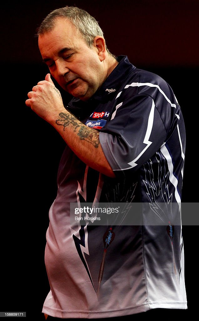 Phil Taylor of England reacts during the final of the 2013 Ladbrokes.com World Darts Championship against Michael van Gerwen of the Netherlands at the Alexandra Palace on January 1, 2013 in London, England.