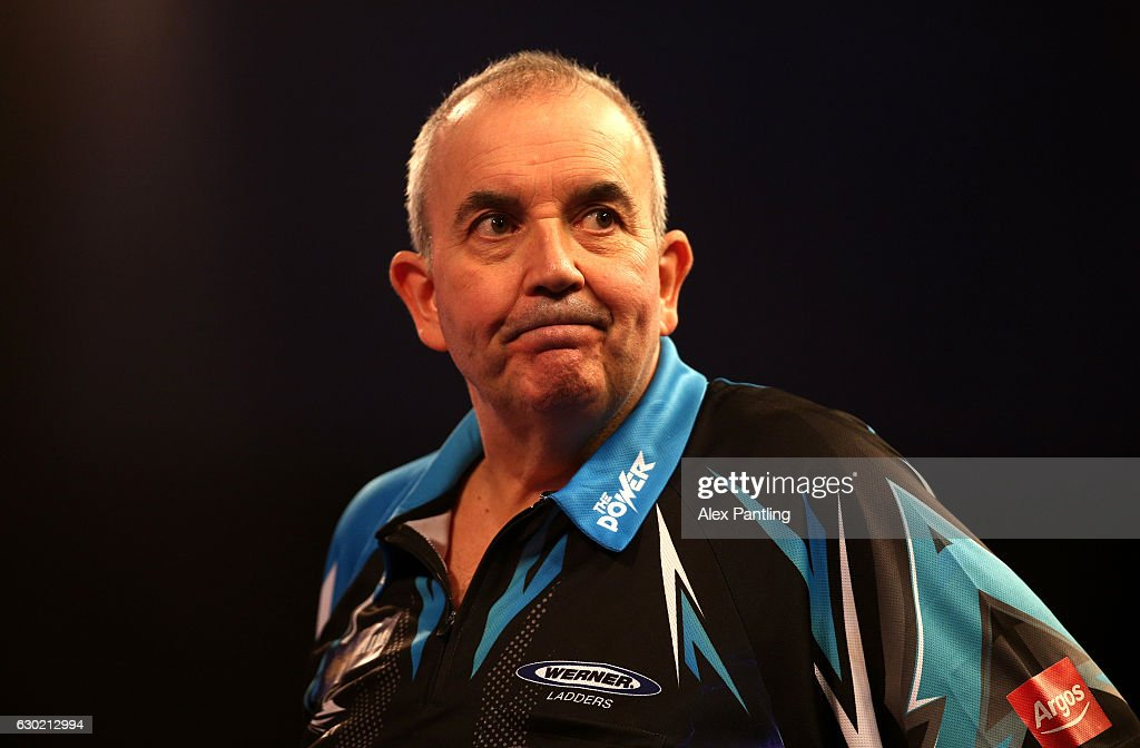 Phil Taylor of England reacts his first round match against David Platt of England during Day Four of the 2017 William Hill PDC World Darts Championships at Alexandra Palace on December 18, 2016 in London, England.