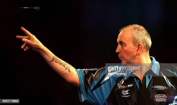 Phil Taylor of England throws during his first round match against David Platt of England during Day Four of the 2017 William Hill PDC World Darts...