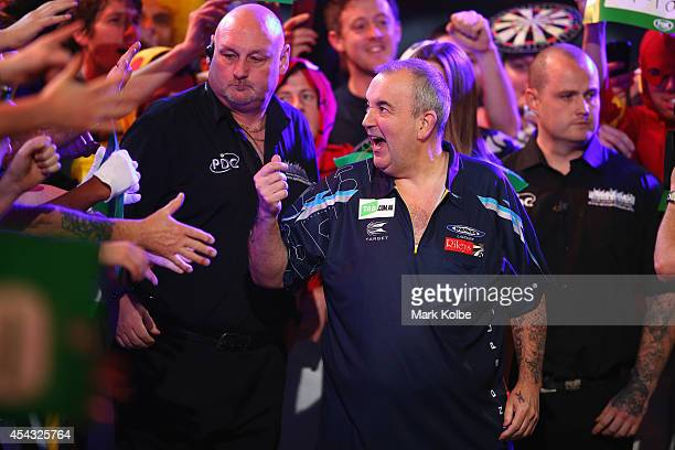 Phil Taylor of England walks to the stage during his quarterfinal match against Dave Chisnall of England during the Sydney Darts Masters at Hordern...