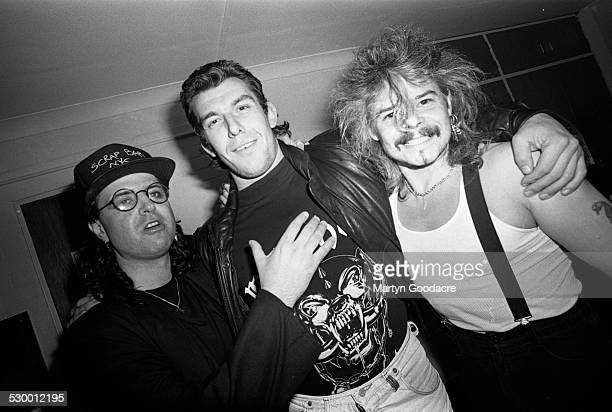 Phil Taylor of Motorhead posed with fans Portsmouth United Kingdom 1991