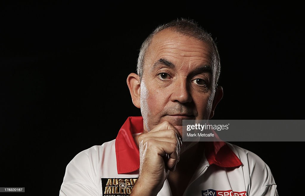 Phil Taylor poses for a portrait ahead of the Sydney Darts Masters at Luna Park on August 29, 2013 in Sydney, Australia.