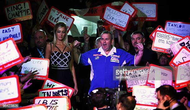 Phil Taylor walks out before facing Steve Hine of England during the 2010 Ladbrokescom World Darts Championship Round One at Alexandra Palace on...