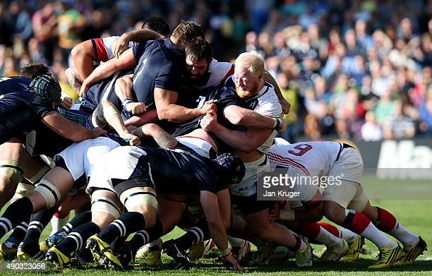 Phil Thiel and Eric Fry of the United States battles in the scrum with Fraser Brown and Jon Welsh of Scotland during the 2015 Rugby World Cup Pool B...