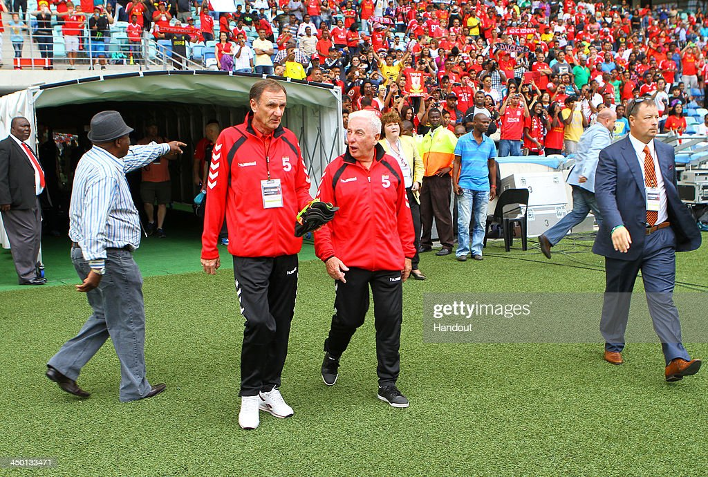 Phil Thompson and Roy Evans (R) walk out of the tunnel during the Legends match between Liverpool FC Legends and Kaizer Chiefs Legends at Moses Mabhida Stadium on November 16, 2013 in Durban, South Africa.