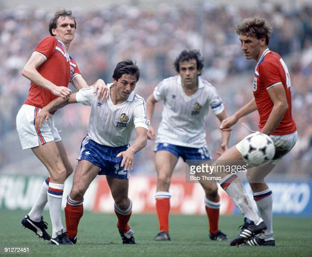Phil Thompson and Terry Butcher of England with Alain Giresse and Michel Platini of France watching the ball during the England v France World Cup...