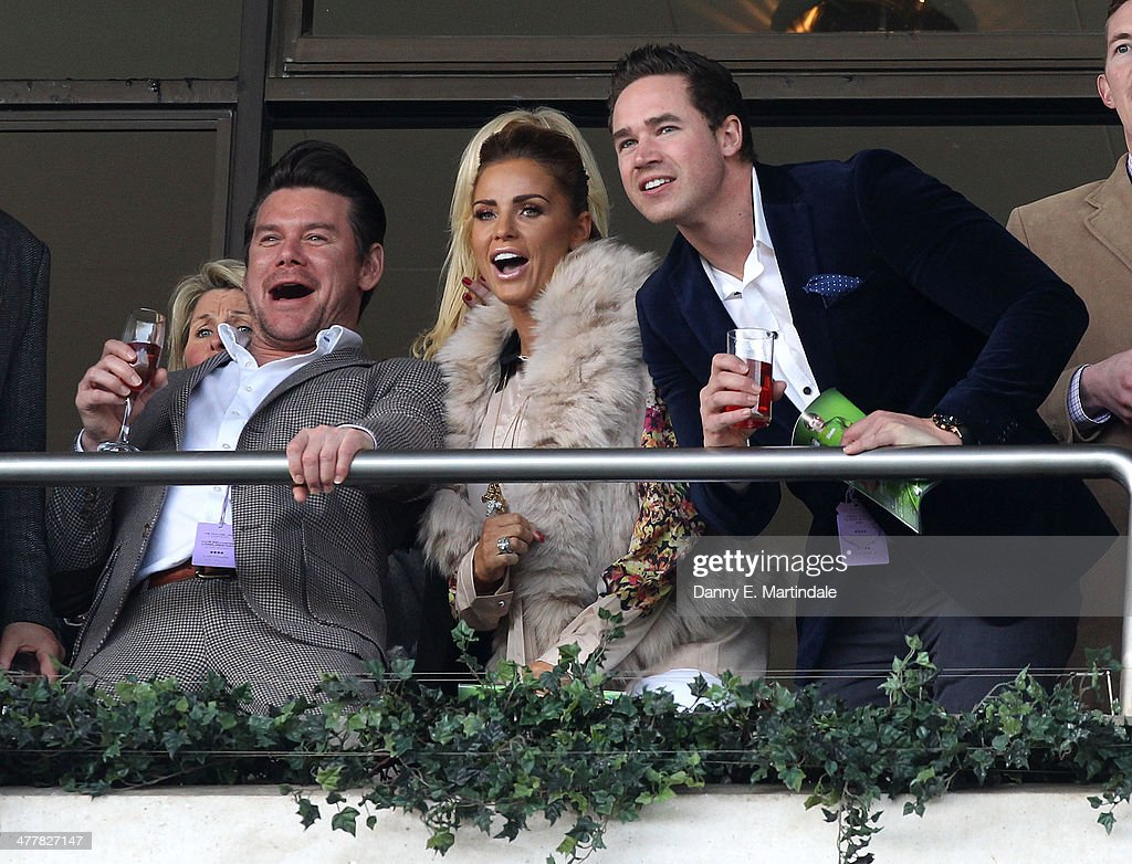 Phil Turner, <a gi-track='captionPersonalityLinkClicked' href=/galleries/search?phrase=Katie+Price&family=editorial&specificpeople=260303 ng-click='$event.stopPropagation()'>Katie Price</a> and husband <a gi-track='captionPersonalityLinkClicked' href=/galleries/search?phrase=Kieran+Hayler&family=editorial&specificpeople=10801396 ng-click='$event.stopPropagation()'>Kieran Hayler</a> watch the second race on day 1 of The Cheltenham Festical at Cheltenham Racecourse on March 11, 2014 in Cheltenham, England.