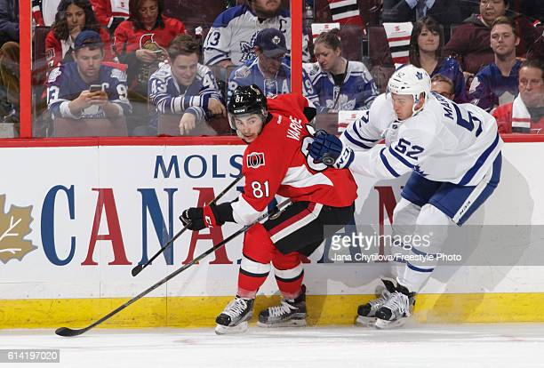 Phil Varone of the Ottawa Senators battles against Martin Marincin of the Toronto Maple Leafs at Canadian Tire Centre on October 12 2016 in Ottawa...