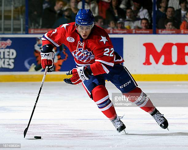 Phil Varone of the Rochester Americans carries the puck against the Toronto Marlies during AHL game action December 1 2012 at Ricoh Coliseum in...