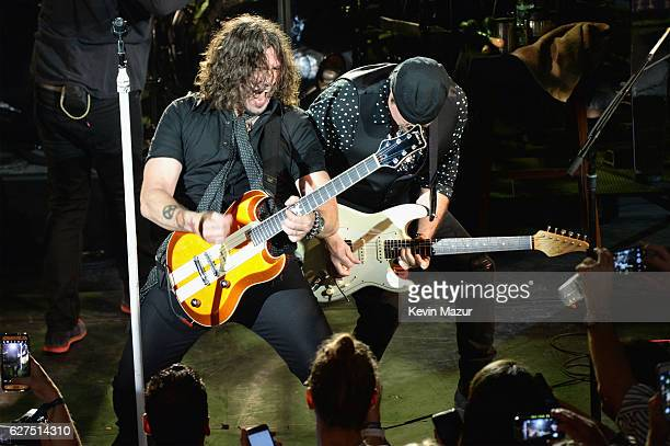 Phil X and John Shanks perform onstage during Bon Jovi Live presented by SiriusXM during Art Basel at the Faena Theater on December 3 2016 in Miami...