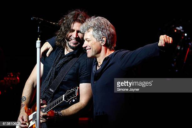 Phil X and Jon Bon Jovi of Bon Jovi perform songs from their new album 'This House Is Not For Sale' at London Palladium on October 10 2016 in London...