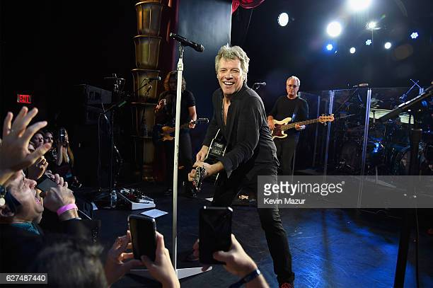 Phil X Jon Bon Jovi and Hugh McDonald of Bon Jovi perform during Bon Jovi Live presented by SiriusXM during Art Basel at the Faena Theater on...