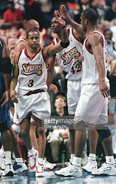 Philadelphia 76er Allen Iverson is congratulated by teammate George Lynch near the end of the first half of action against the Orlando Magic 25 April...