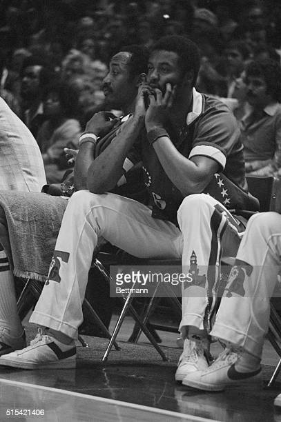 Philadelphia 76er teammates Joe Bryant and George McGinnis sit on the bench and watch their team lose to the Washington Bullets in Game 4 of the 1978...