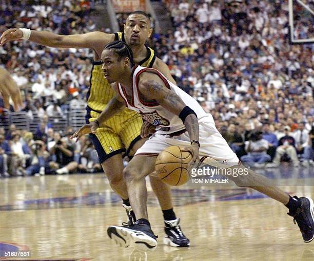 Philadelphia 76ers' Allen Iverson drives past Indiana Pacers Mark Jackson during the fourth quarter of game three in round two of the NBA Eastern...
