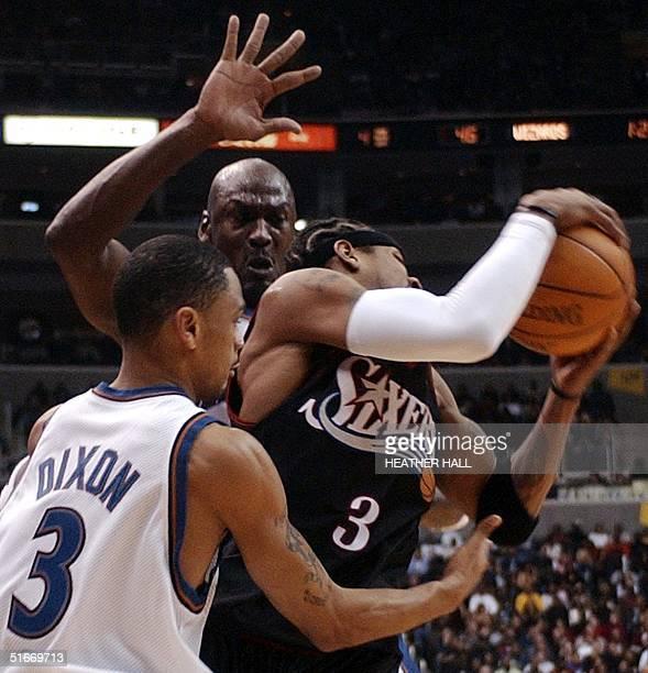Philadelphia 76ers' Allen Iverson is doubleteameb by Washington Wizards' Michael Jordan Juan Dixon in the second quarter 30 November 2002 at the MCI...