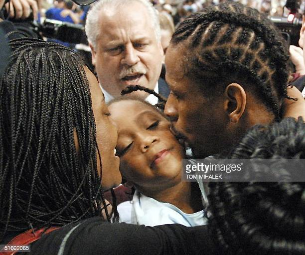 Philadelphia 76ers' Allen Iverson kisses his daughter Tiaura beside his wife Tawanna after the 76ers won game seven of the NBA Eastern Conference...