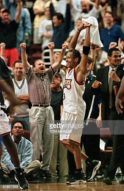 Philadelphia 76ers Allen Iverson raises his arms in triumph as the Sixers defeat the Orlando Magic 10191 15 May 1999 in Philadelphia The Sixers took...