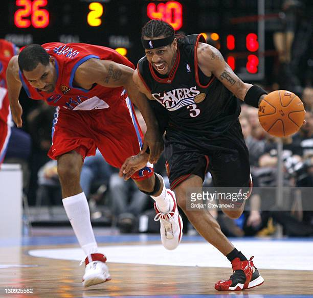 Philadelphia 76ers Allen Iverson right fight for the ball with David Vanterpoll left of CSKA Moscow during a NBA Live Tour basketball match between...