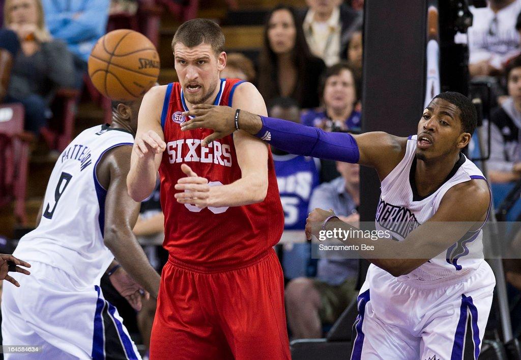 Philadelphia 76ers center Spencer Hawes battles Sacramento Kings power forward Jason Thompson for a rebound in an NBA basketball game at Sleep Train...