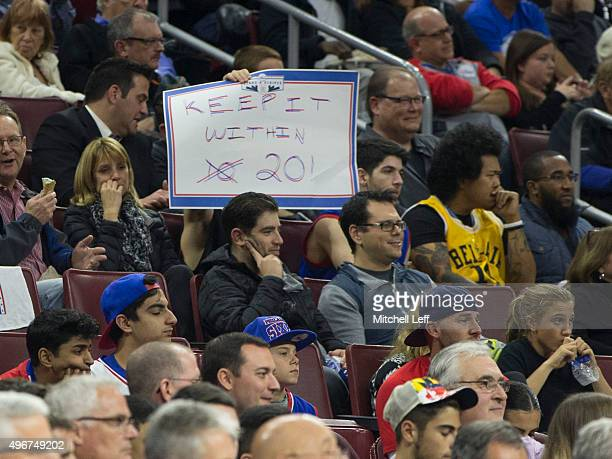 Philadelphia 76ers fan holds up a sign that reads 'Keep it within 20' during the game against the Toronto Raptors on November 11 2015 at the Wells...