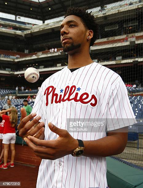 Philadelphia 76ers first round draft pick Jahlil Okafor gets set to throw out the first pitch prior to the start of a MLB game between the...