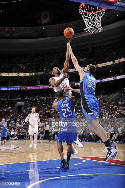 Philadelphia 76ers forward Thaddeus Young fights for the ball control with Orlando Magic power forward Ryan Anderson during the game against the...