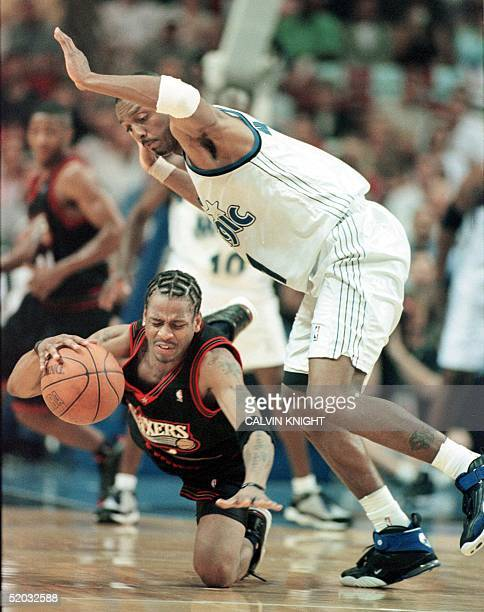 ORLANDO FL MAY 11 Philadelphia 76ers guard Allen Iverson falls to the court under pressure from Orlando Magic guard Anfernee Hardaway during the...