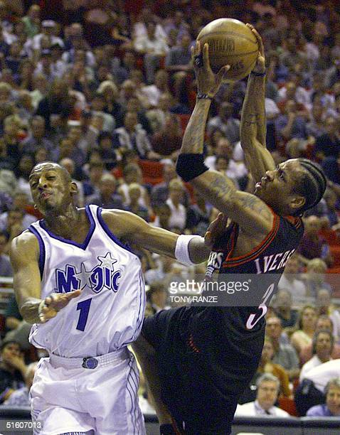 Philadelphia 76ers guard Allen Iverson fights for control of a rebound with Orlando Magic guard Anfernee Hardaway during the second period of game...