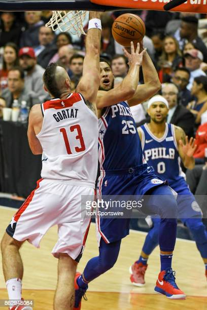 Philadelphia 76ers guard Ben Simmons scores in the second half against Washington Wizards center Marcin Gortat on October 18 2017 at the Capital One...