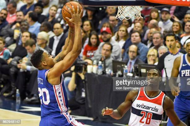 Philadelphia 76ers guard Markelle Fultz goes to the basket against Washington Wizards center Ian Mahinmi on October 18 2017 at the Capital One Arena...