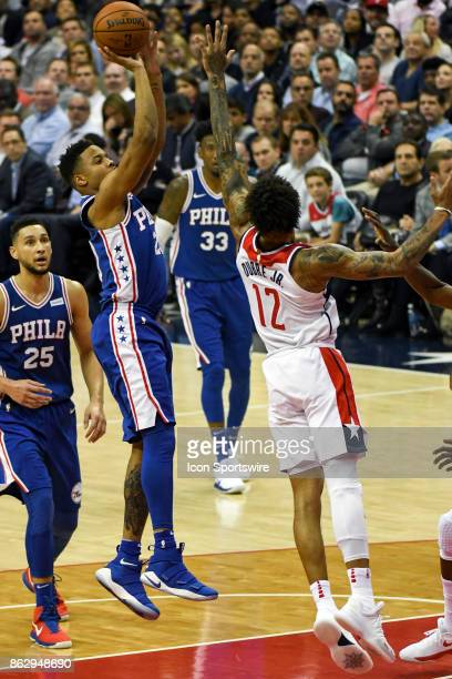 Philadelphia 76ers guard Markelle Fultz scores against Washington Wizards forward Kelly Oubre Jr on October 18 2017 at the Capital One Arena in...