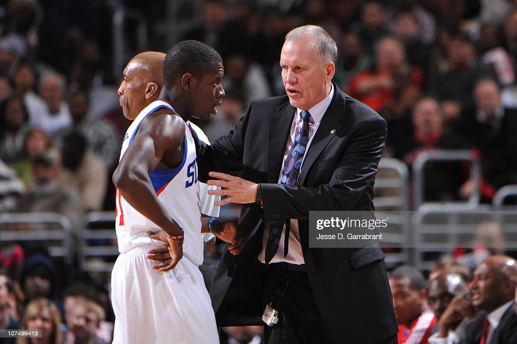Philadelphia 76ers Head Coach Doug Collins talks to Jrue Holiday the 76ers during the game against the Boston Celtics on December 9 2010 at the Wells...