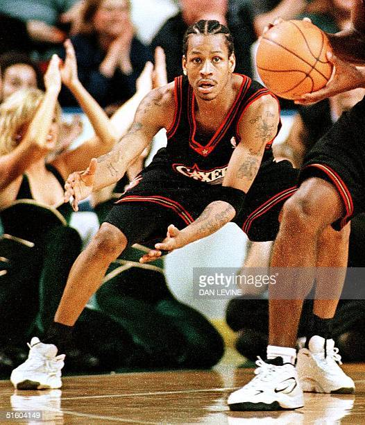 Philadelphia 76ers player Allen Iverson looks for a pass from teammate George Lynch during their game against the Seattle SuperSonics 22 March 1999...