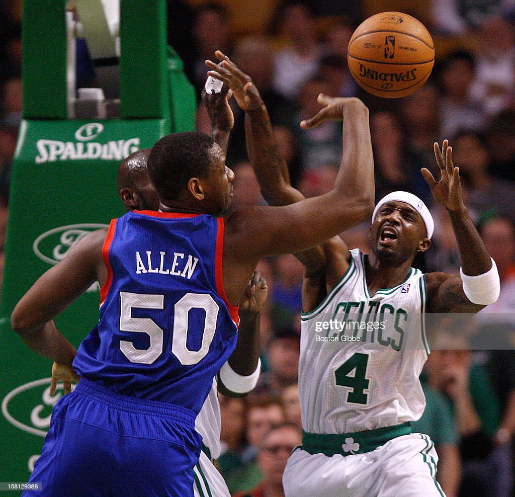 Philadelphia 76ers power forward Lavoy Allen (#50) and Boston Celtics shooting guard Jason Terry (#4) battle for a defensive rebound during the first quarter as the Celtics play the Philadelphia 76ers at TD Garden.
