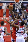 Philadelphia 76ers small forward Thaddeus Young scores against Washington Wizards power forward Kevin Seraphin in the fourth quarter at the Verizon...