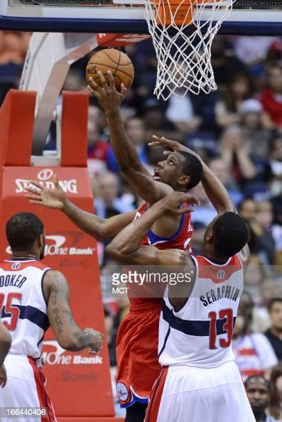 Philadelphia 76ers small forward Thaddeus Young scores against Washington Wizards power forward Kevin Seraphin in the fourth quarter at the Verizon...