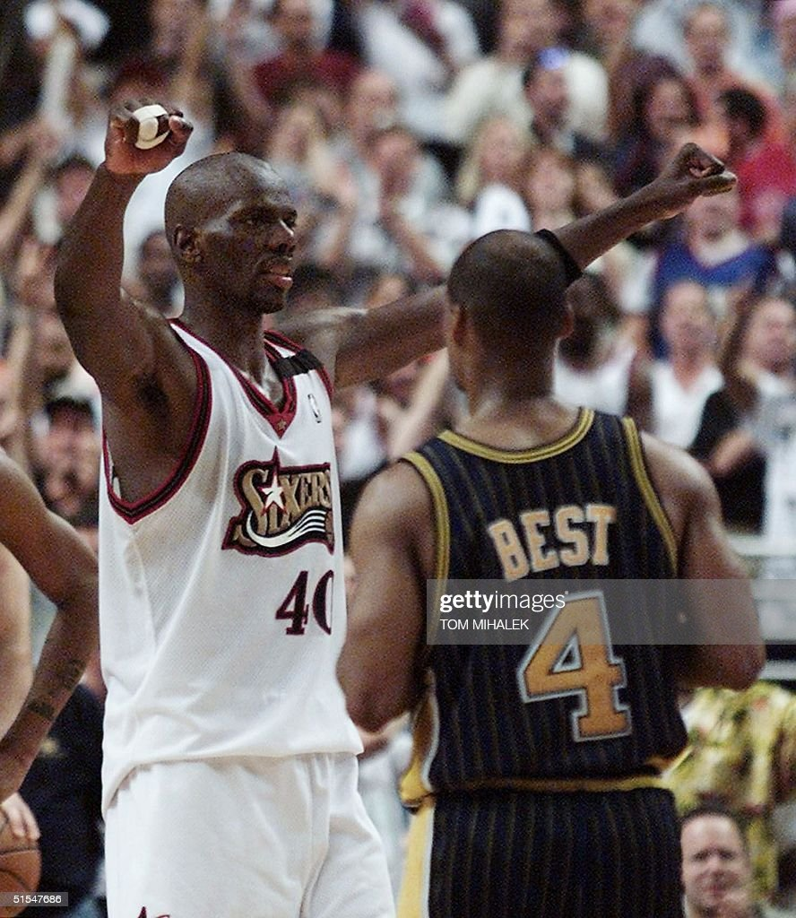 Philadelphia 76ers Tyrone Hill L celebrates in