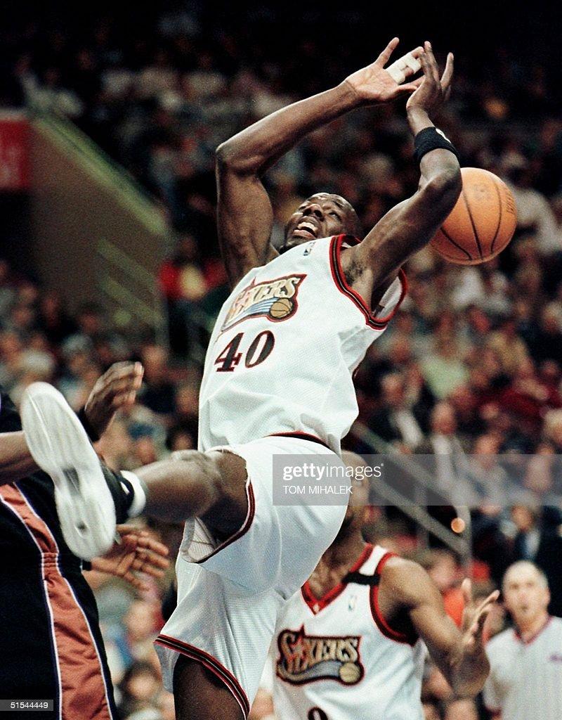 Philadelphia 76ers Tyrone Hill L falls backwards